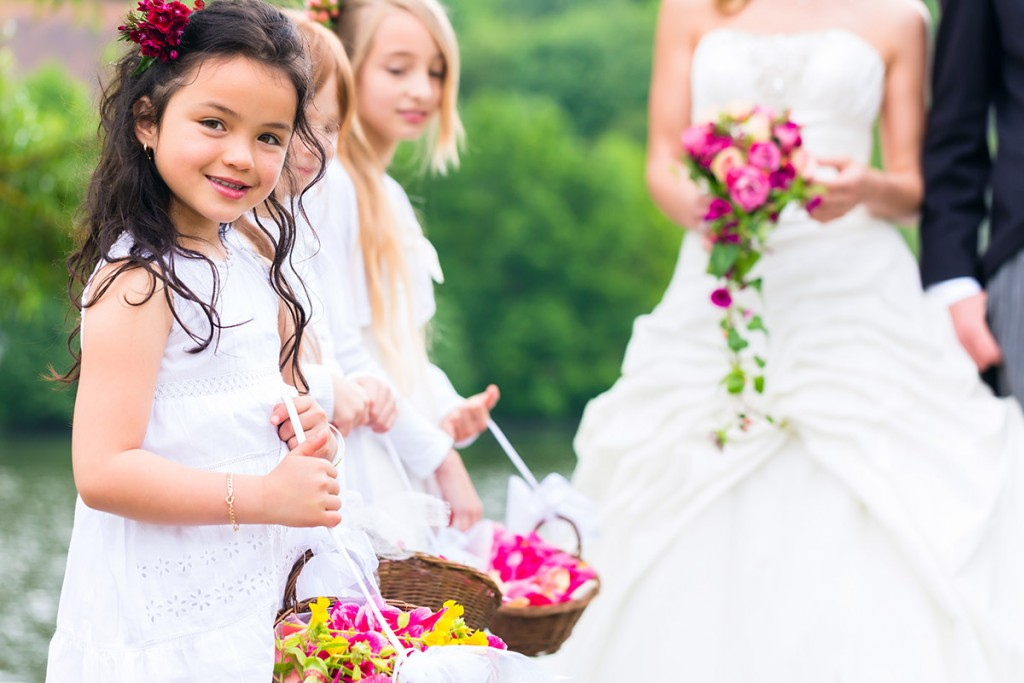 Wedding bride and groom with flower-children or bridesmaid in white dress